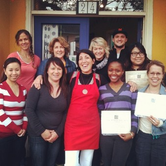 Alice Duvernell of Biophelia Botanicals with her Students Holding Certificates of Completion in Front of The Nova Studio in Point Richmond, CA