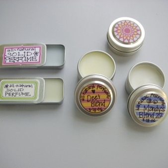 Solid Perfumes in Metal Tins Marked with Handwritten, Colorful Labels