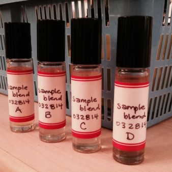 Glass Roller Bottles with Perfume Samples, Marked with Handwritten Red & White Labels