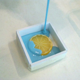 Pouring Liquid Silicone Over a Slice of Citrus to Create a Cavity Mold
