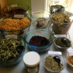 Bowls of Herbs: Rose Petals, Calendula Petals, Lemon Verbena, Thyme Leaves, Hibiscus, Marshmallow Root, Comfrey, Chamomile, Peppermint, Rosemary & Orange Peel